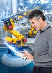 In zukunftsfähigen Produktionsnetzwerken können offene Manufacturing Operation Systems dafür sorgen, dass sich etwa Industrieroboter und mobile Endgeräte leicht und flexibel anbinden lassen. Bild: ©Nataliya Hora/Fotolia.com, ©stocknroll/Istock.com