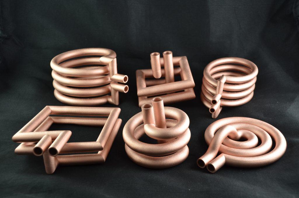 Induktionsspulen aus dem 3D-Drucker: Online konfigurierte Induktionsspulen aus elektrisch hochleitfähigem Kupfer bieten zahlreiche Vorteile. (Bild: Phoenix Contact Deutschland GmbH)