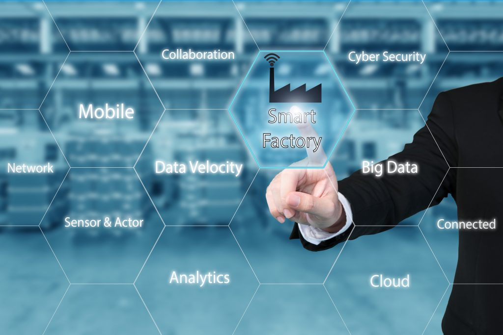 Business man touching smart factory icon in virtual interface screen showing data of smart factory. Business industry 4.0 concept. (Bild: ©ake1150sb/istockphoto.com)