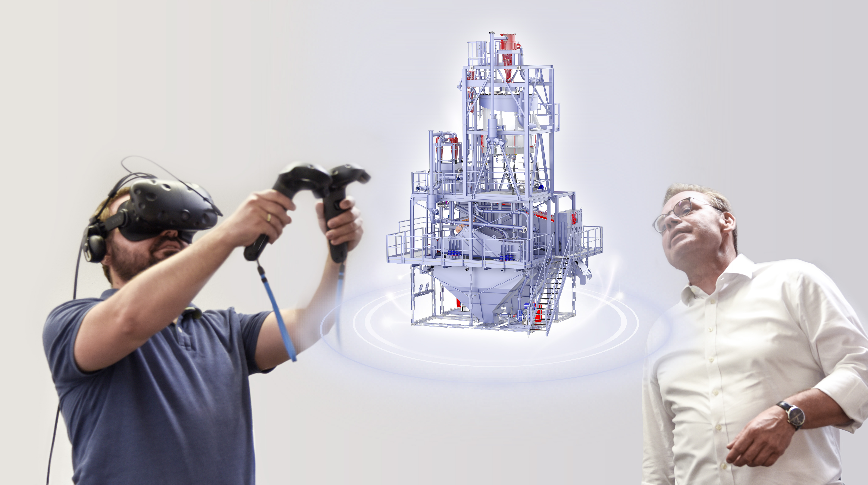 Daniel Hübner (links), WeAre, und Norman Perten (rechts),Vertriebsleiter bei Schauenburg, mit dem 3D-Modell eines Zentrifugencontainers von Schauenburg. (Bild: Sputnik GmbH)